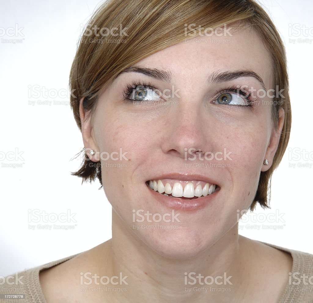 Happy woman looking up stock photo