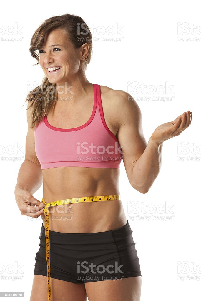 Happy woman measuring her waist royalty-free stock photo