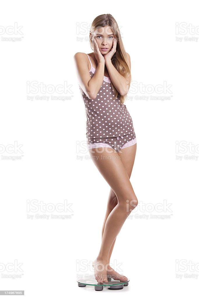 Happy woman measuring her weight stock photo