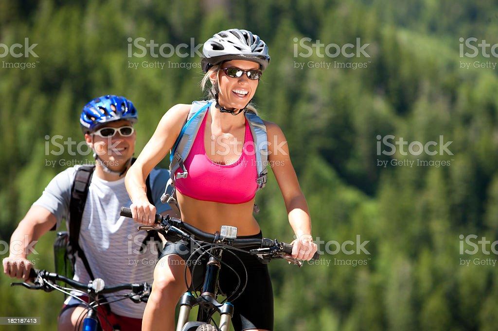 Happy Woman Mountain Biking royalty-free stock photo