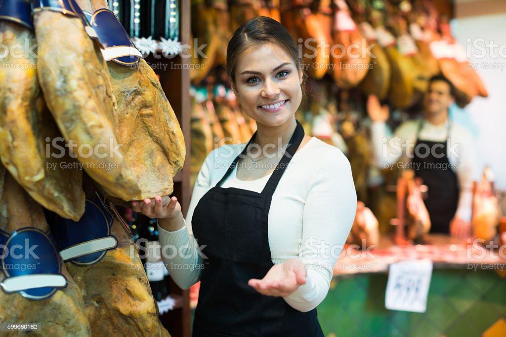 Happy woman offering tasty jamon stock photo