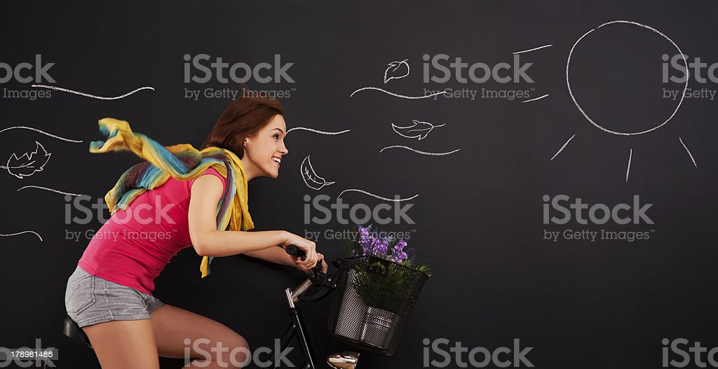 Happy woman on a bicycle royalty-free stock photo