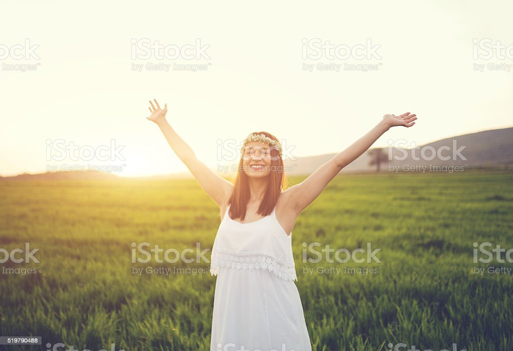 Happy woman on a green filed stock photo