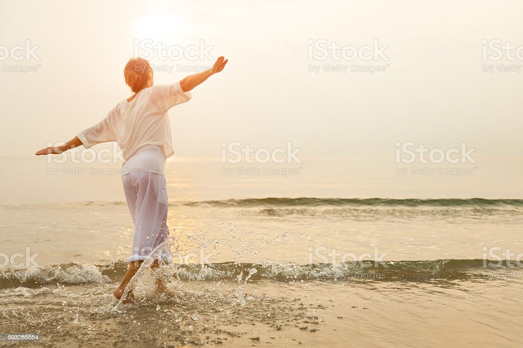 Happy woman on beach stock photo