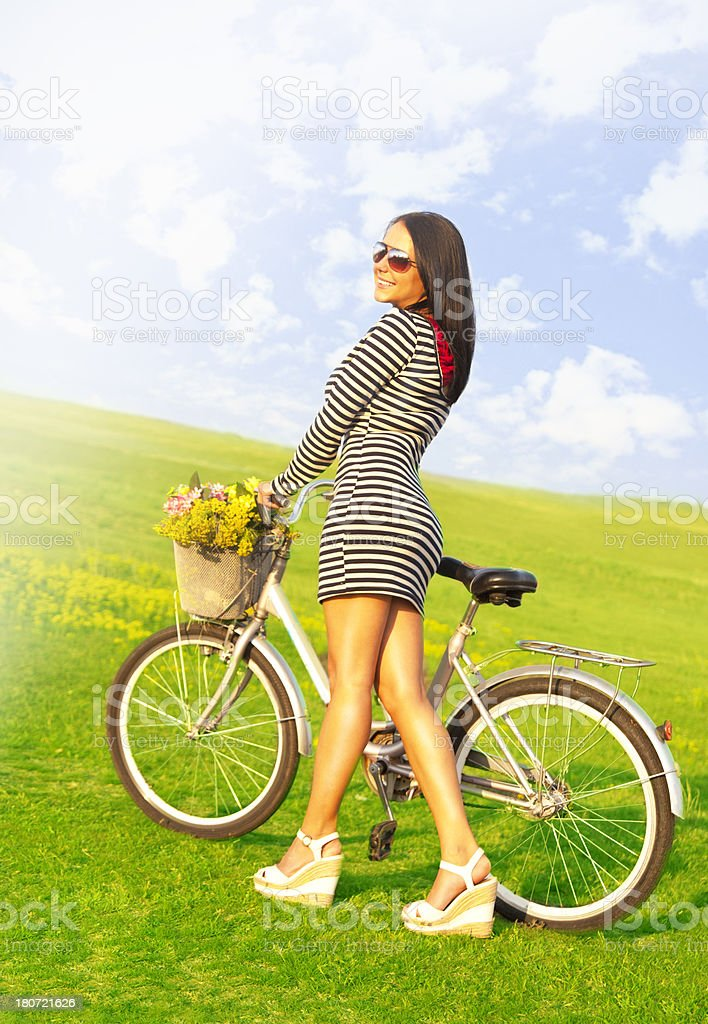 Happy woman on cycle ride in countryside royalty-free stock photo