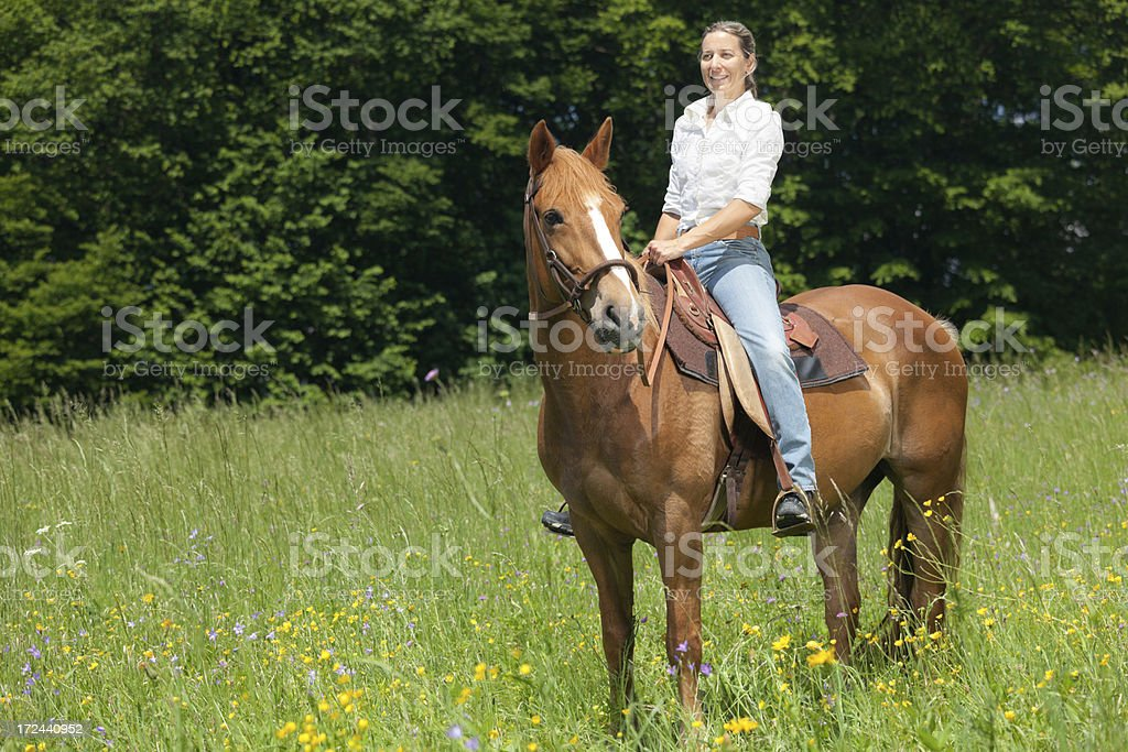 happy woman on horse royalty-free stock photo