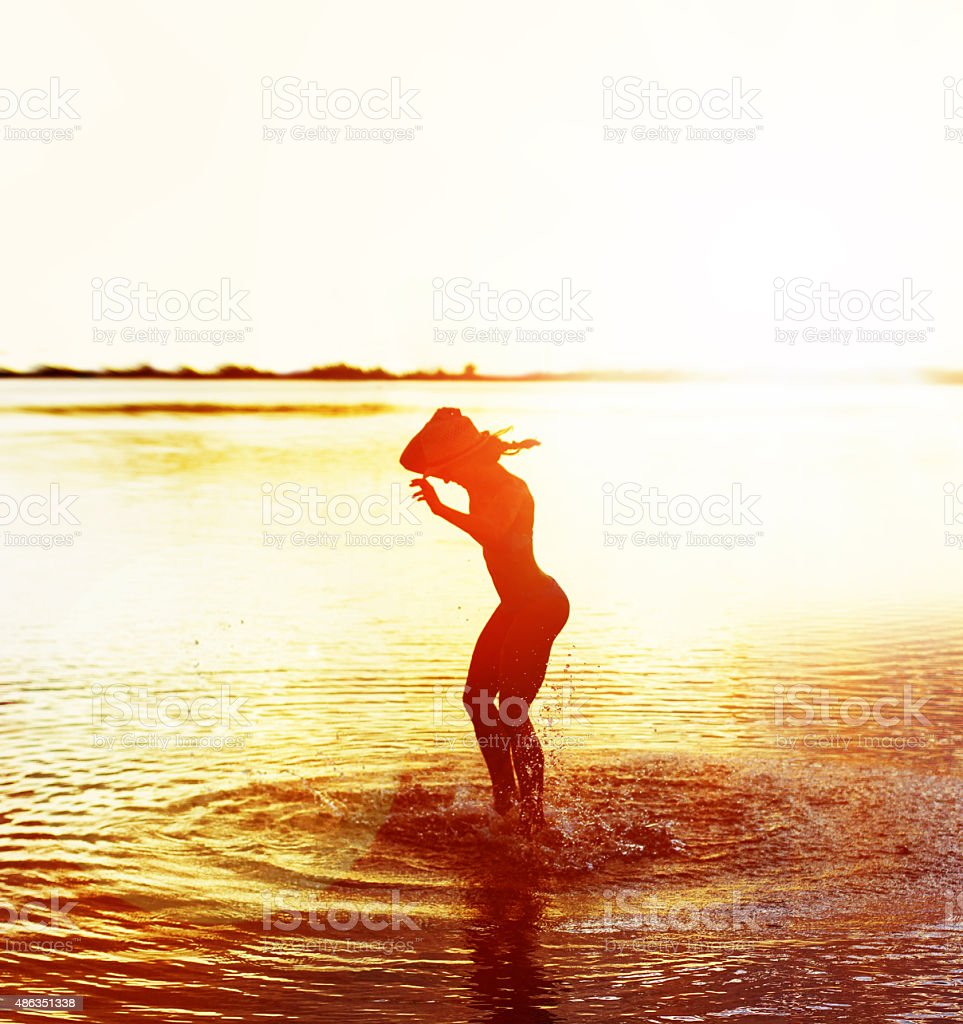 Happy woman on in the sea stock photo