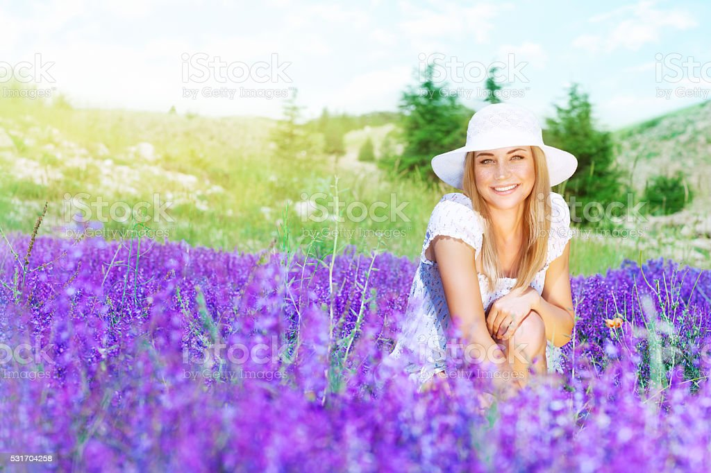 Happy woman on lavender field stock photo