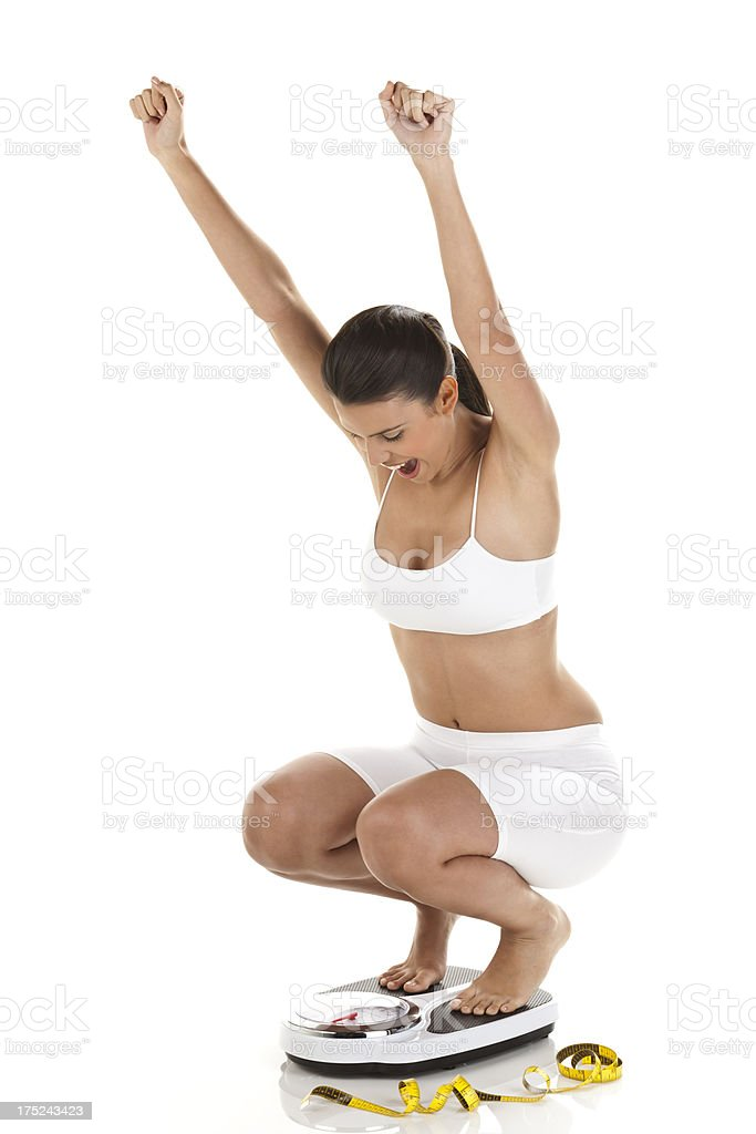 Happy woman on scale royalty-free stock photo