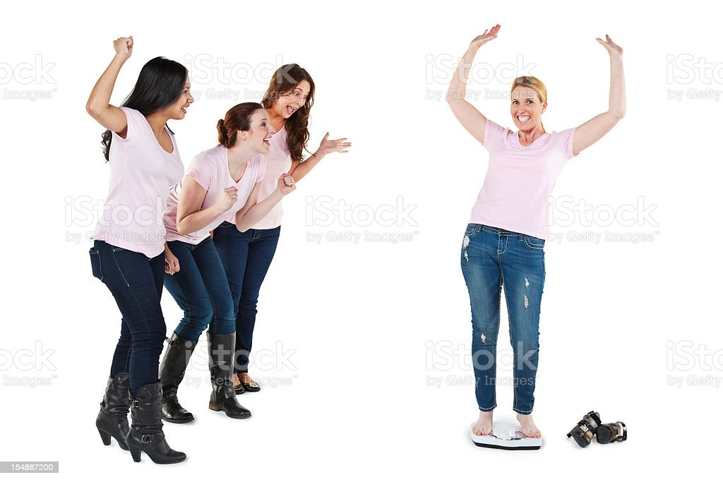 Happy Woman on Scale With Friends Cheering For Her royalty-free stock photo