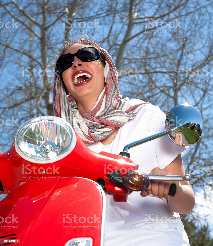 Happy woman on scooter stock photo