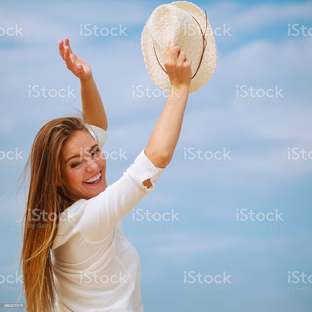 Happy woman on summer beach. stock photo