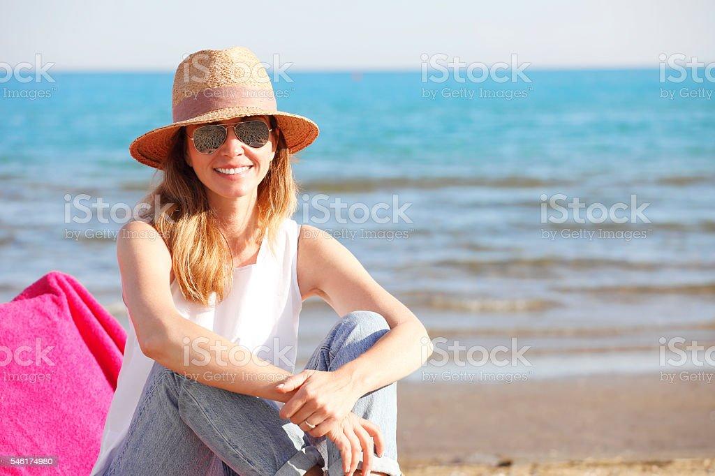 Happy woman on the beach stock photo