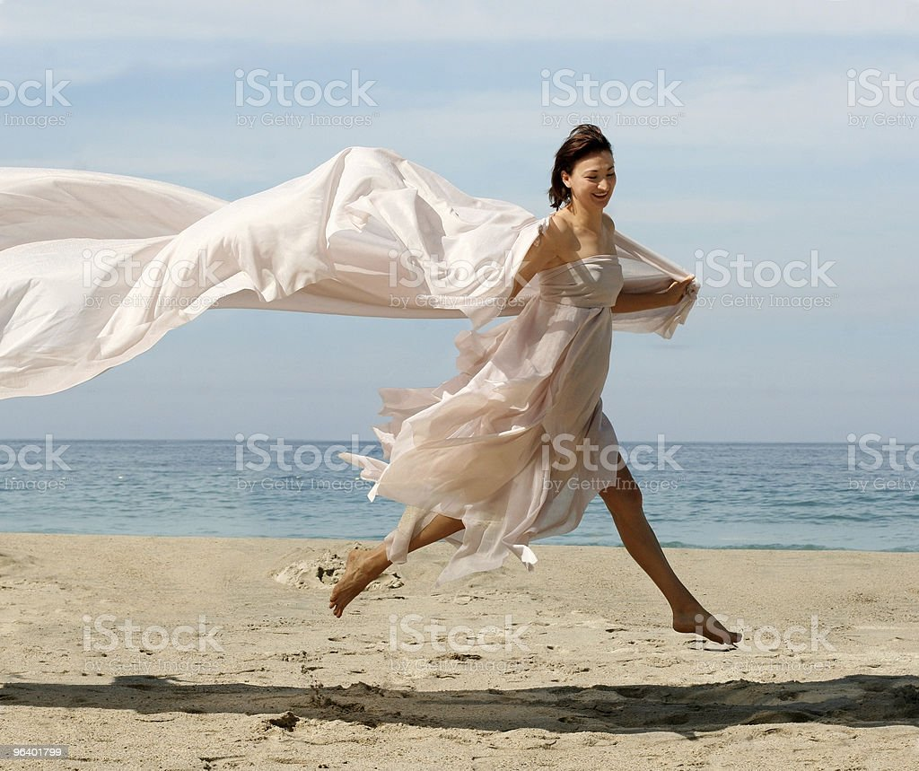 Happy woman on the beach royalty-free stock photo