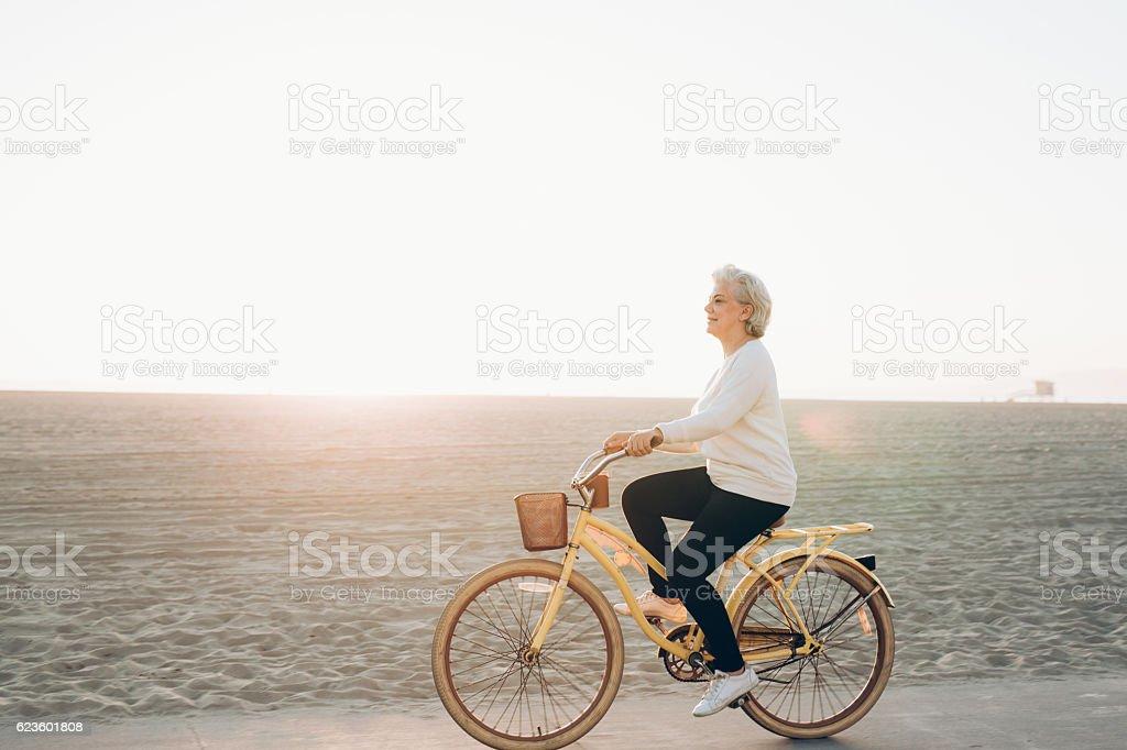Happy woman on the bike stock photo