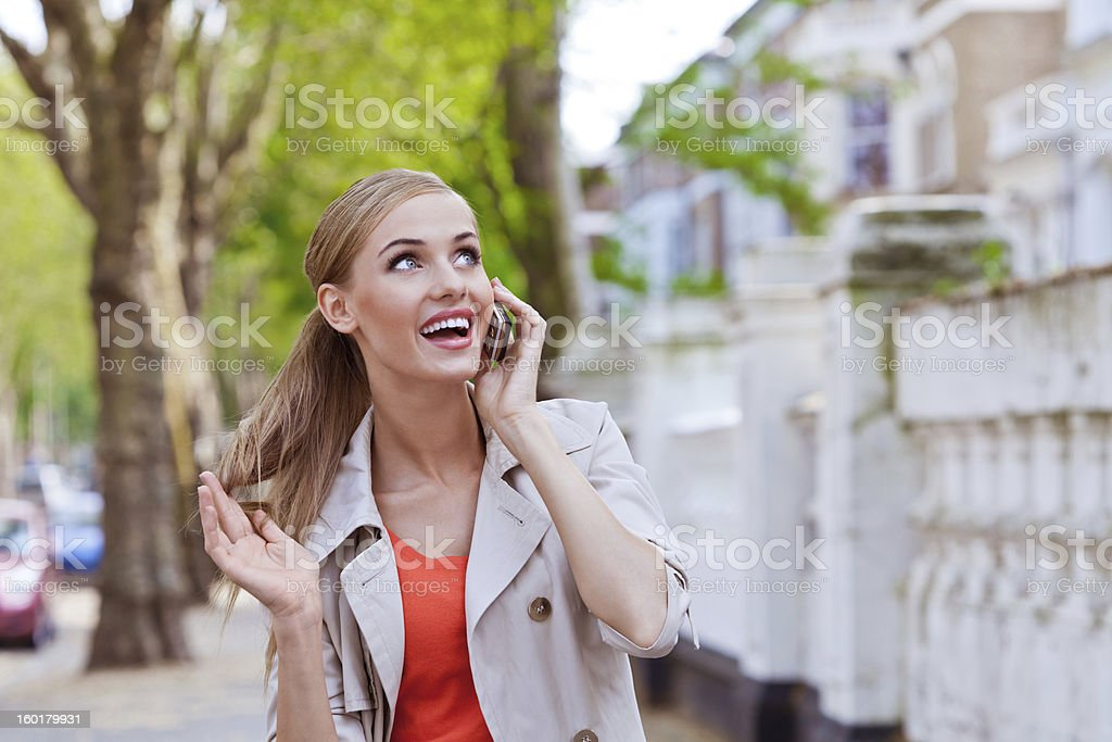 Happy woman on the phone royalty-free stock photo