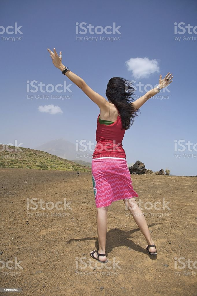 happy woman open arms fly greeting blue sky royalty-free stock photo
