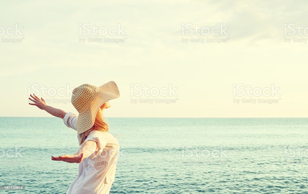 Happy woman  opened his hands, enjoys sunset stock photo