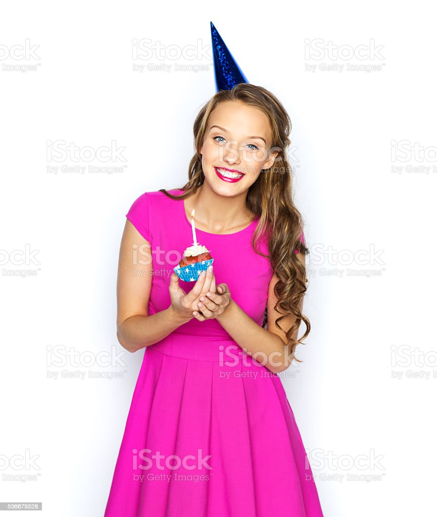 happy woman or teen girl with birthday cupcake stock photo