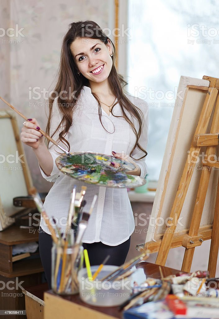 Happy  woman paints on canvas royalty-free stock photo