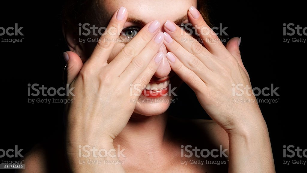 Happy woman peeping stock photo