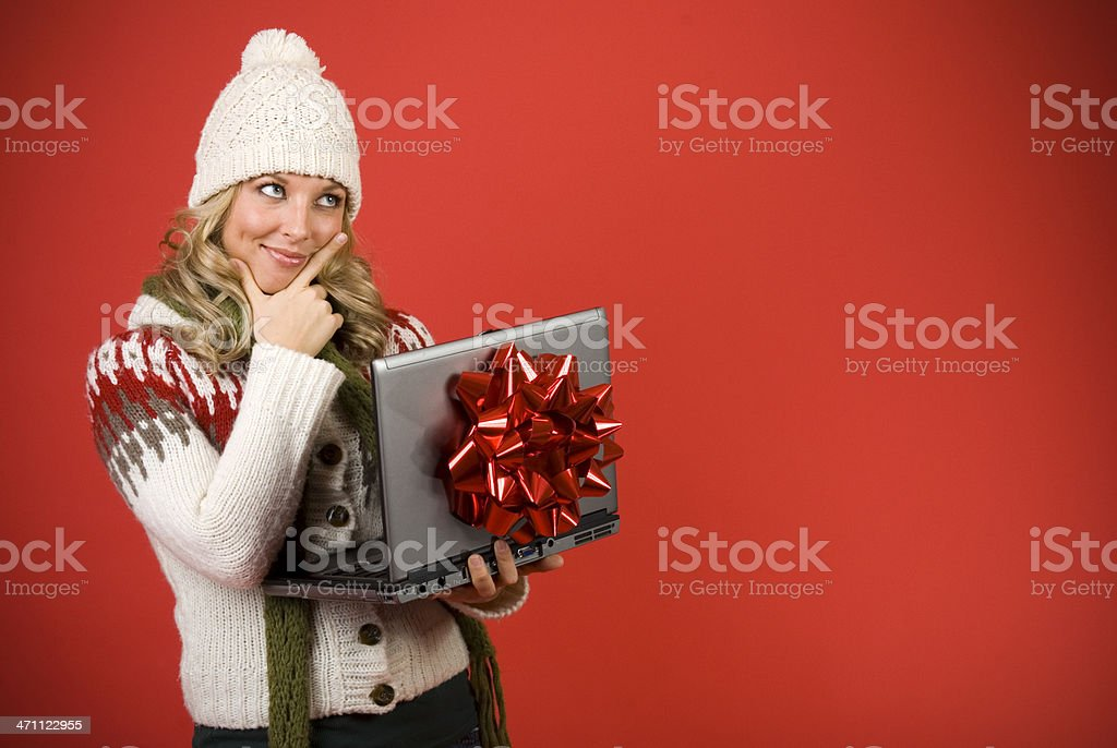 Happy Woman Planning With Laptop Computer For Christmas royalty-free stock photo