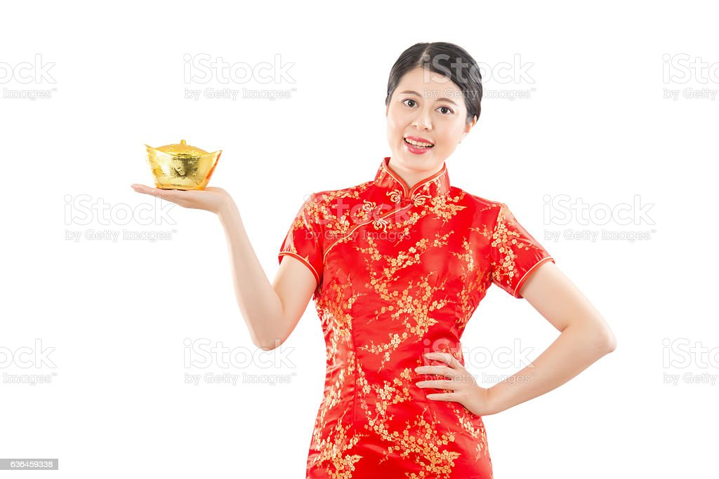 happy woman presenting golden ingot stock photo