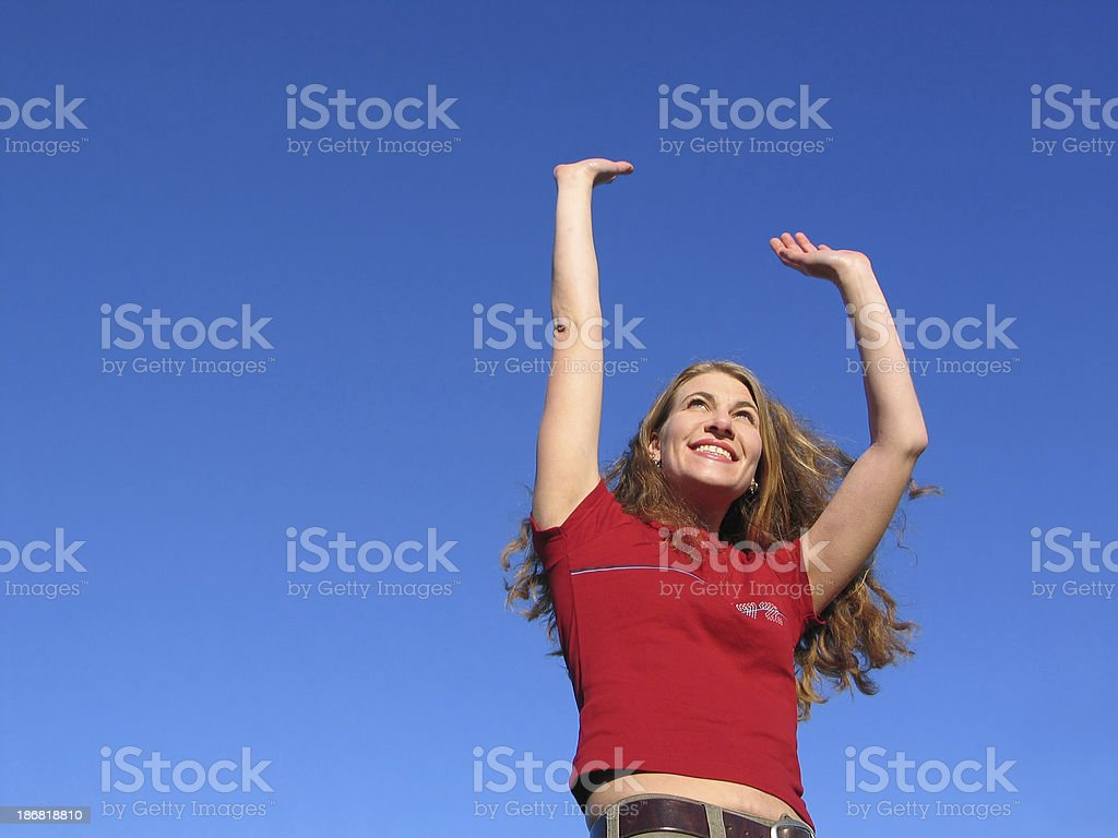 Happy woman reaching for the sky royalty-free stock photo
