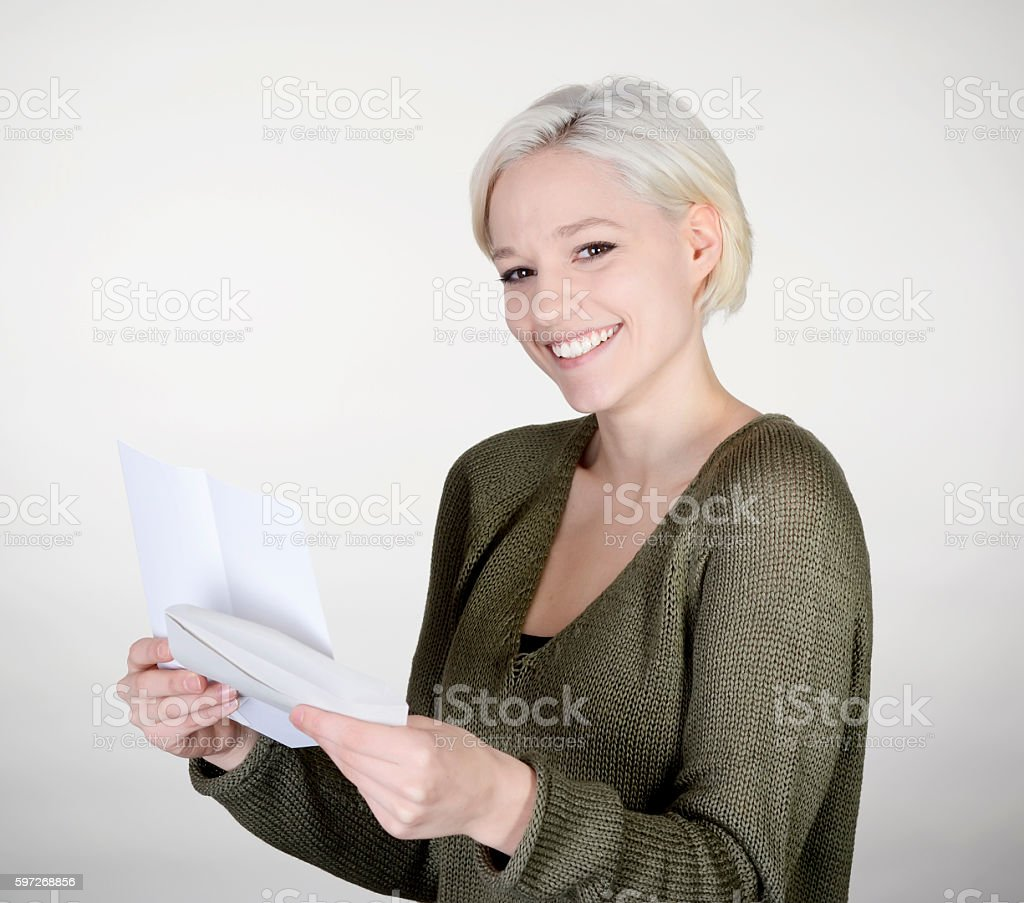 happy woman reading letter stock photo