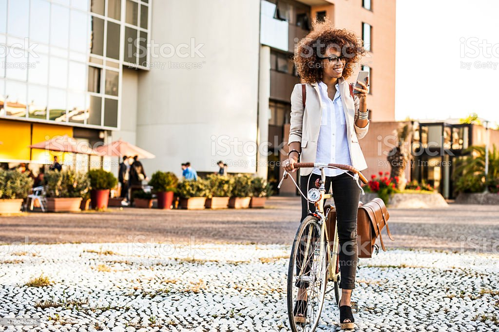 Happy woman ready to drive her cycle stock photo