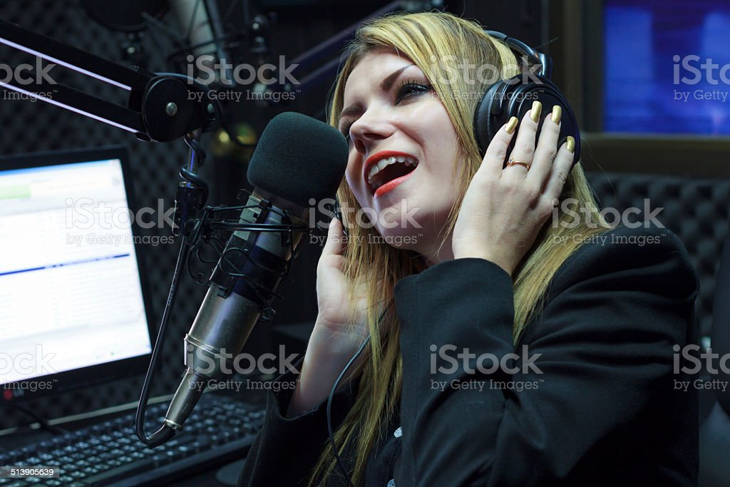 Happy Woman Recording And Singing stock photo