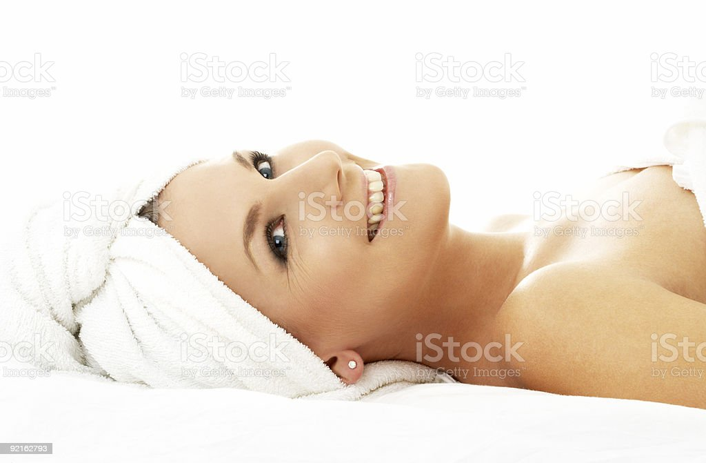 A happy woman relaxing at the spa royalty-free stock photo