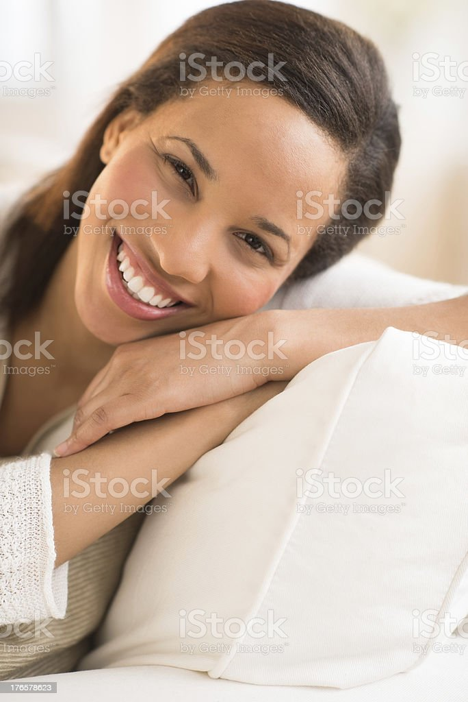 Happy Woman Relaxing On Cushion At Home royalty-free stock photo