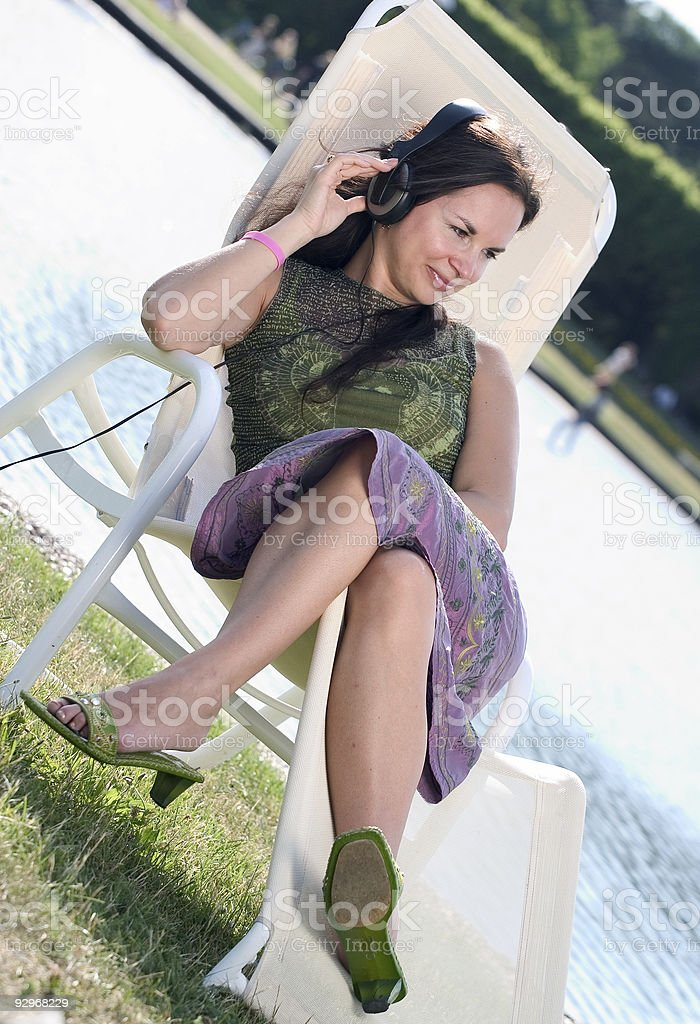 Happy woman relaxing stock photo