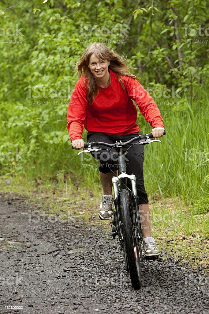 happy woman riding bike. royalty-free stock photo