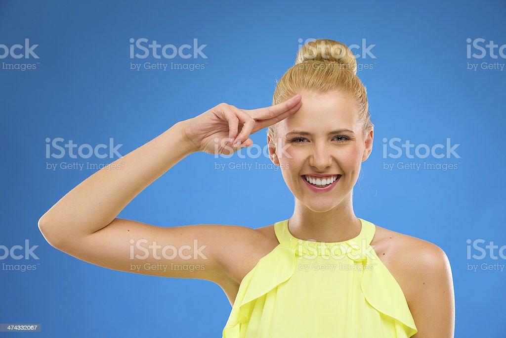 Happy woman saluting. royalty-free stock photo