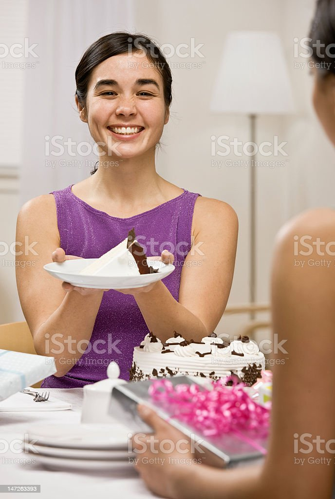 Happy woman serving birthday cake at party royalty-free stock photo