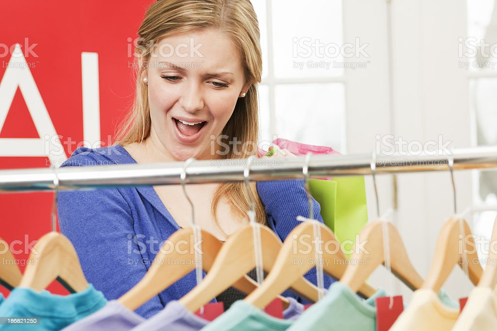 Happy Woman Shopper Shopping in a Clothing Retail Sale royalty-free stock photo