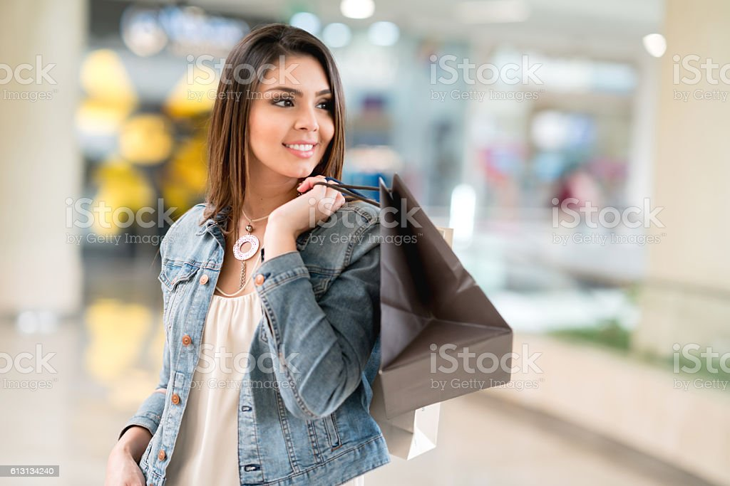 Happy woman shopping at the mall stock photo