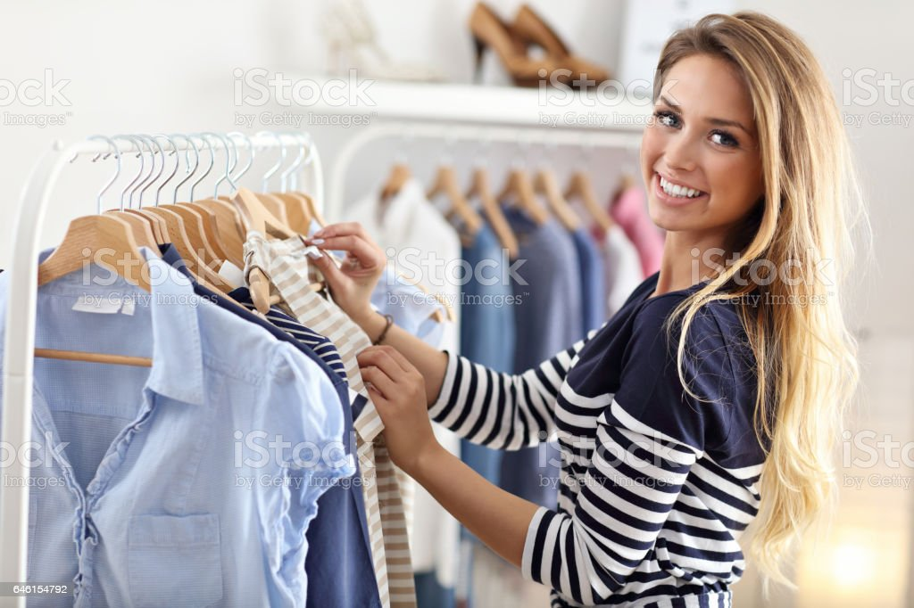 Happy woman shopping for clothes stock photo