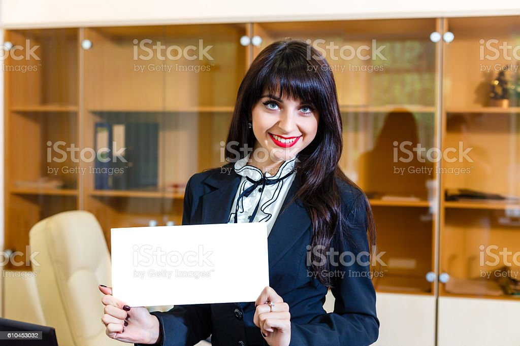 happy woman showing empty card in office stock photo