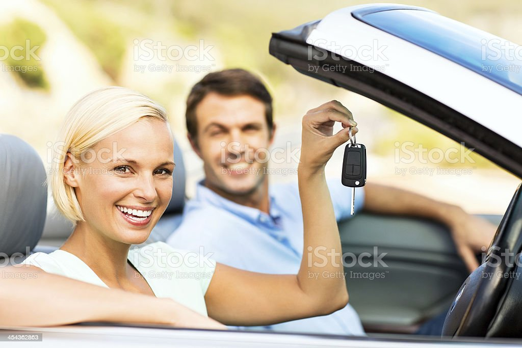Happy Woman Showing Key While Sitting In New Car royalty-free stock photo