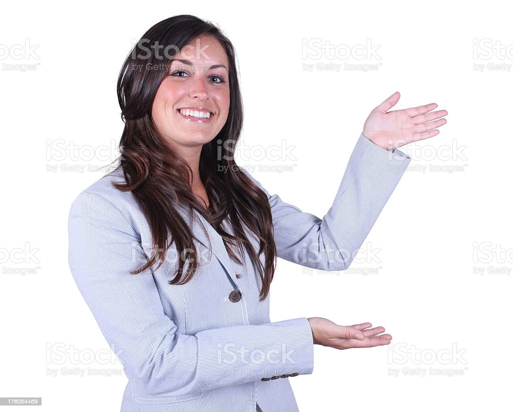 Happy woman showing off amazing product royalty-free stock photo