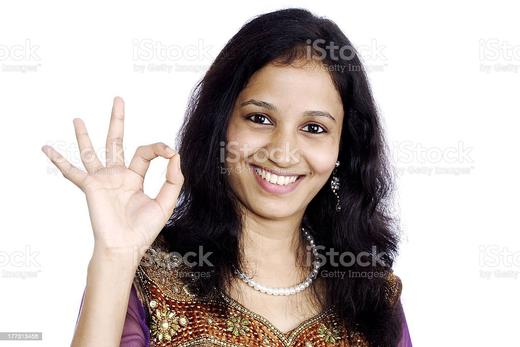 Happy woman showing OK sign royalty-free stock photo
