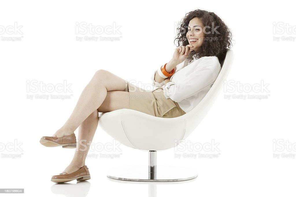 Happy woman sitting on a chair royalty-free stock photo