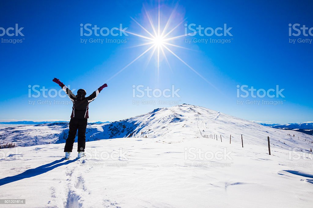 Happy woman skier on top of ski resort stock photo