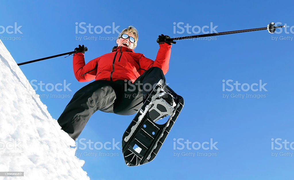 happy woman snowshoeing royalty-free stock photo