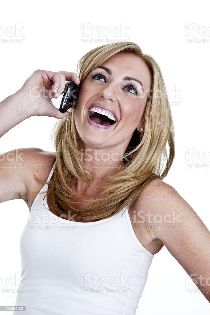 Happy woman speaking on cellular phone royalty-free stock photo