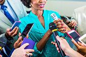 Happy woman speaks to media