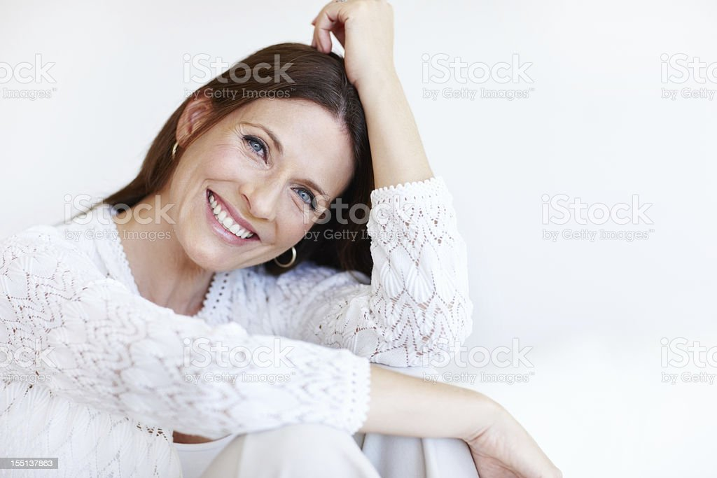 Happy woman spending time at home stock photo